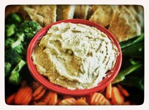 Hummus, veggie and pita platter.